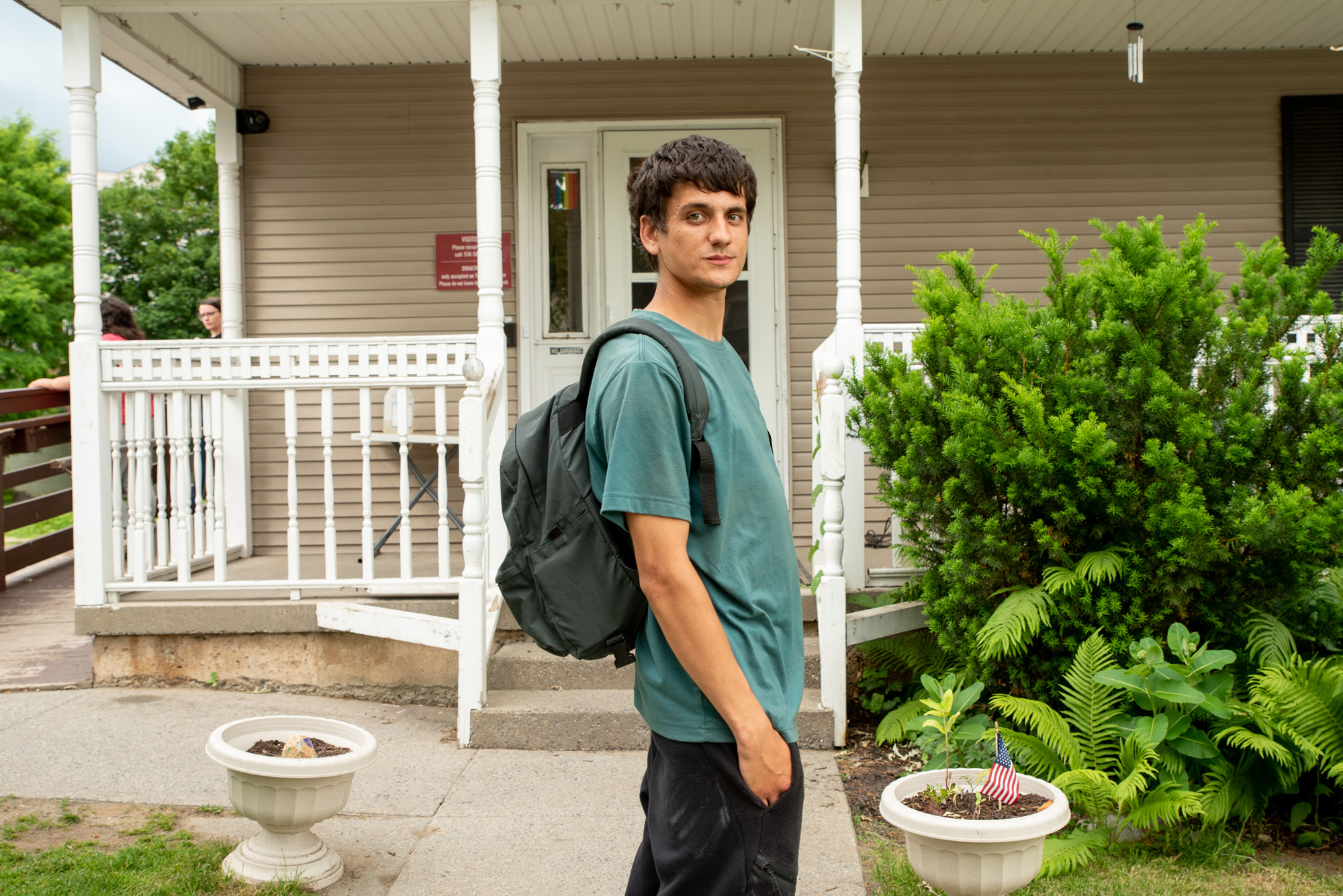 outside shelter-man with backpack