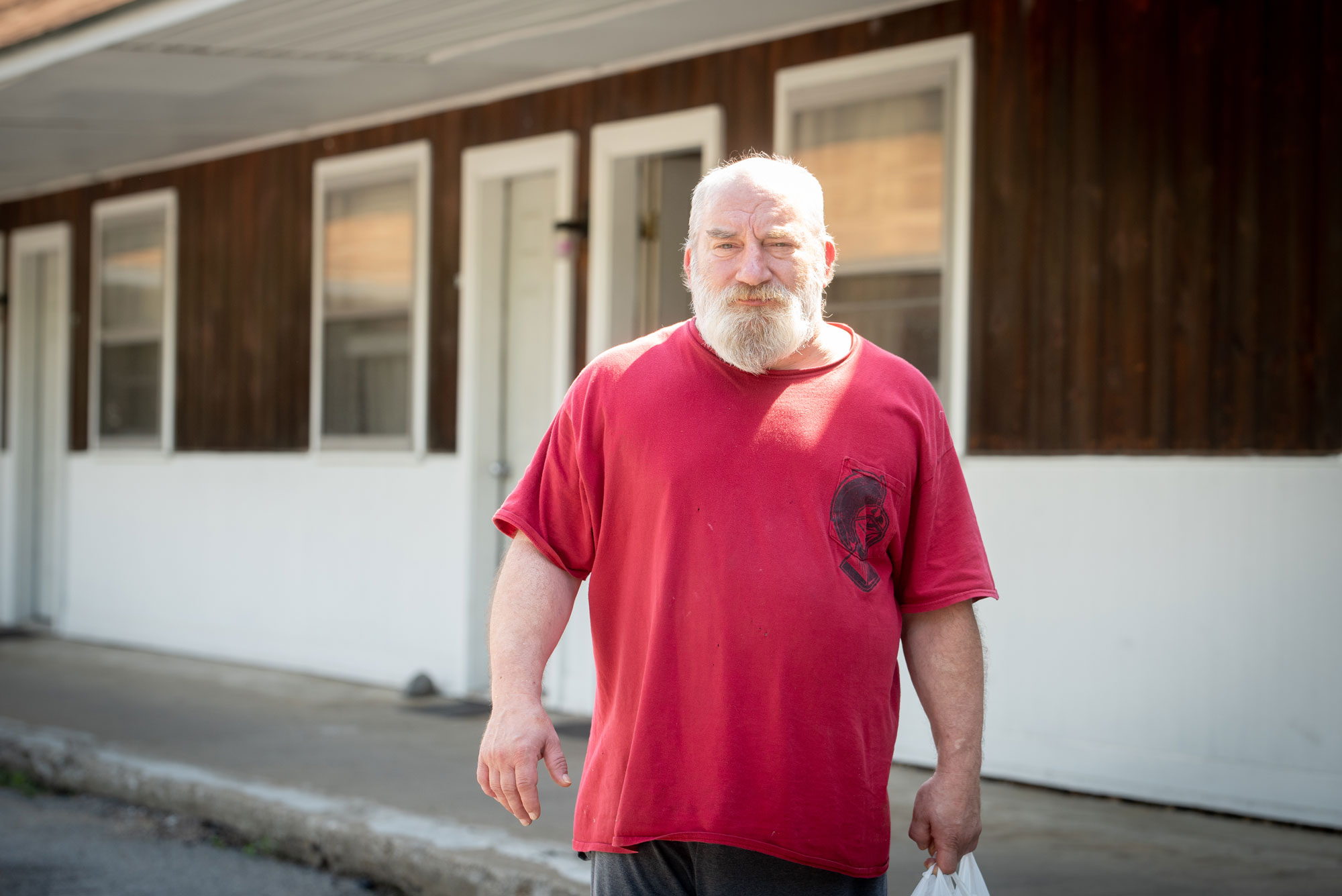 man in front of motel